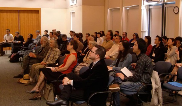 Group of people listening to a speaker