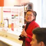 Woman giving a speech at a restaurant, red blazer