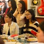 A group of girls listening to a speech